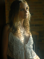 blonde in frilly white under cloths and soft lights.
