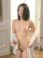 asian girl from next door has a very real moment as she poses in partial undress.