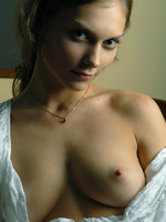 masha has penetrating eyes that stare you down as she removes her clothes.