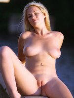 natali reveals her large soft breasts and curvy ass in this windy outdoor shoot.