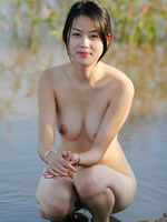 natural asian model plays outdoors and looks so happy.