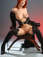 red haired mistress in leather looking very dominant.