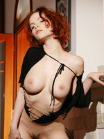 red head has a very evil smile as she removes her clothes and has sex on her mind.