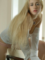 mysterious blonde with cat like features has a very sensual series here.