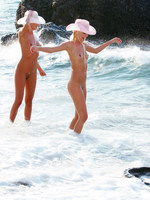 sisters frolic on the beach.
